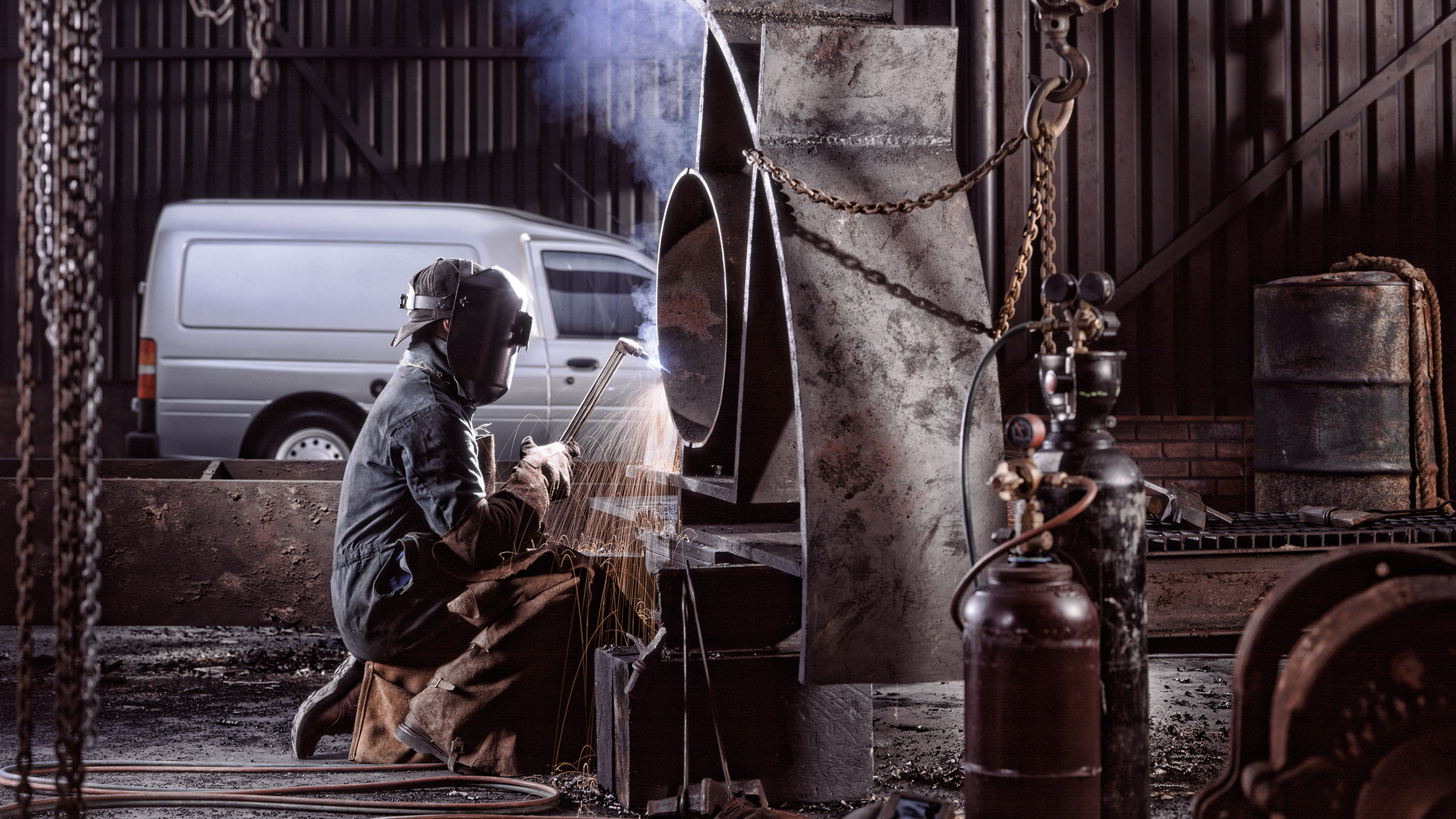 Welder working in an industrial location